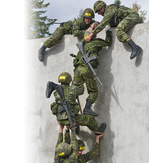A team of Canadian Armed Forces members scaling a wall